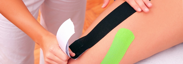 leg being kinesio taped